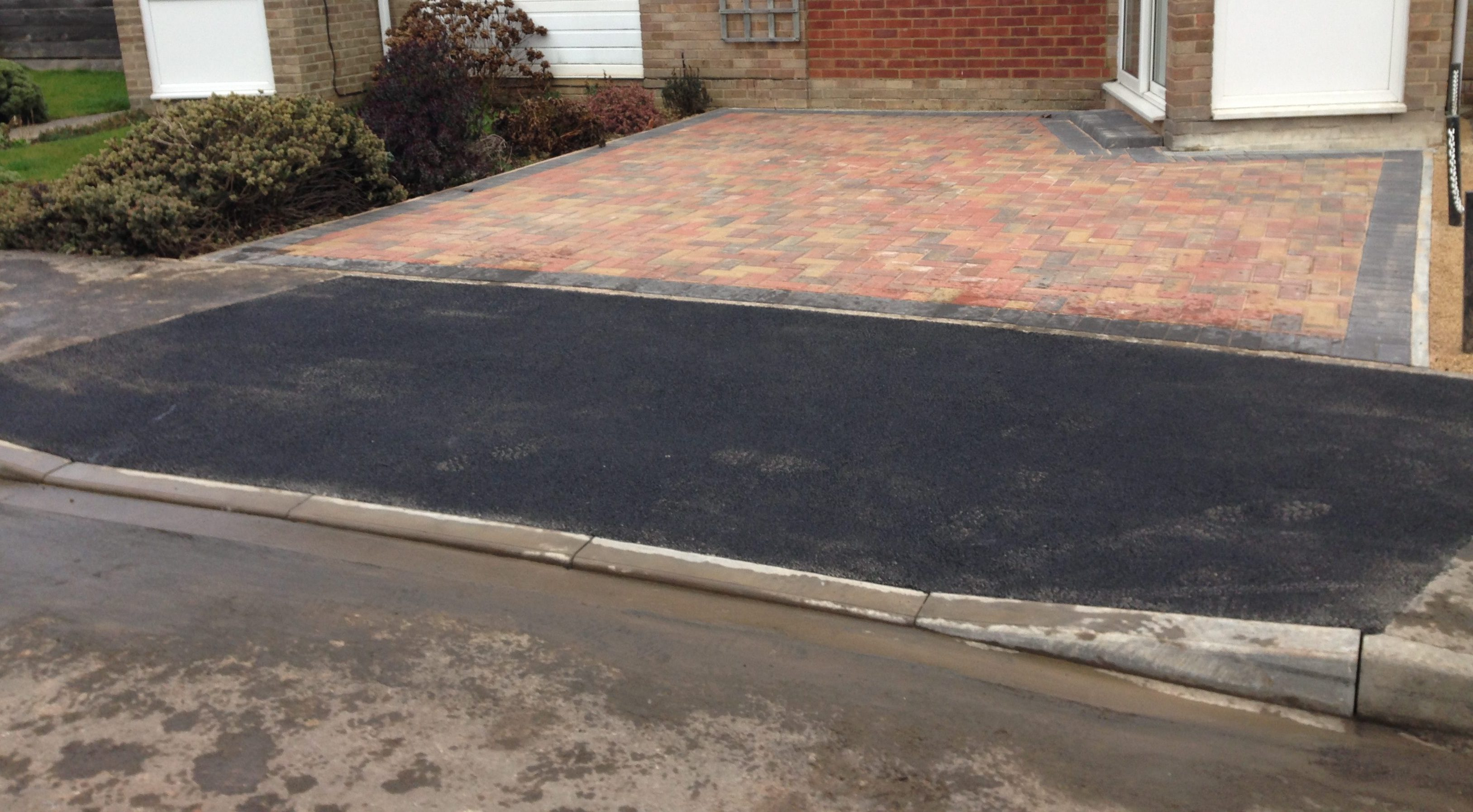 Block paved driveway with step, and dropped kerb