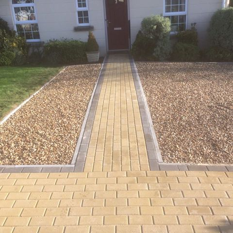 Block paved pathway with gravel driveway